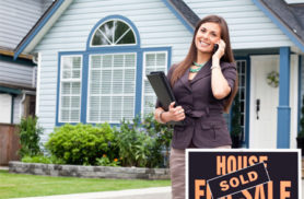 realtor with phone and sold sign